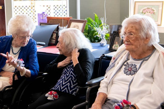 """From left: Lena Waters Carman, 101, Mary Lois Arnold, 103, and Amanda """"Opal"""" James, 105, are honored by the Century Club at The Meadows Lakeshore Senior Living Thursday, Aug. 15, 2019, in Nashville, Tenn."""