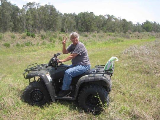 Nancy Olson pictured riding an all-terrain vehicle in Bonita Springs.