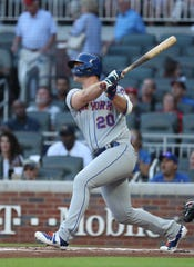 Aug 15, 2019; Atlanta, GA, USA; New York Mets first baseman Pete Alonso (20) hits a three-run home run in the first inning against the Atlanta Braves at SunTrust Park. Mandatory Credit: Jason Getz-USA TODAY Sports