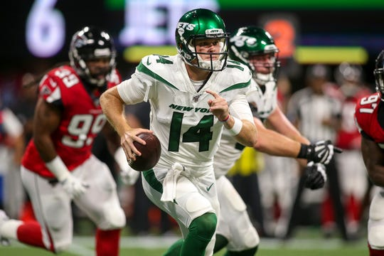 Aug 15, 2019; Atlanta, GA, USA; New York Jets quarterback Sam Darnold (14) scrambles against the Atlanta Falcons in the first quarter at Mercedes-Benz Stadium.