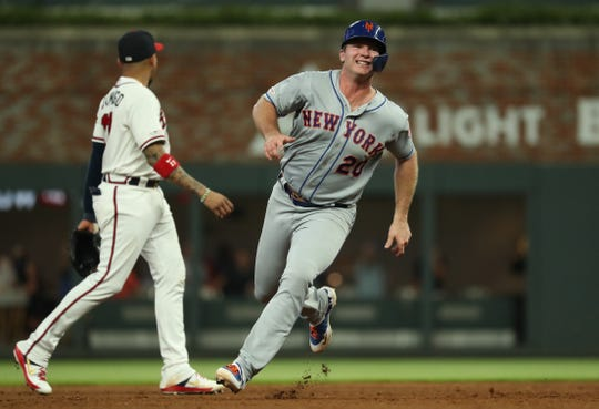 Aug 15, 2019; Atlanta, GA, USA; New York Mets first baseman Pete Alonso (20) runs to third base after a single by right fielder Michael Conforto (not pictured) in the fifth inning against the Atlanta Braves at SunTrust Park. Mandatory Credit: Jason Getz-USA TODAY Sports