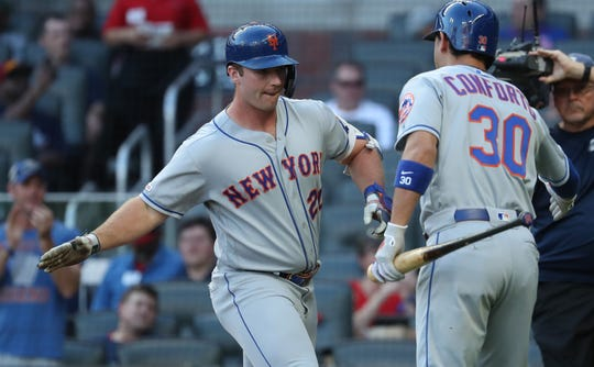 Aug 15, 2019; Atlanta, GA, USA; New York Mets first baseman Pete Alonso (20) celebrates his three-run home run with right fielder Michael Conforto (30) in the first inning against the Atlanta Braves at SunTrust Park. Mandatory Credit: Jason Getz-USA TODAY Sports