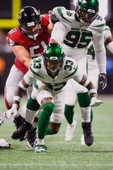 New York Jets strong safety Jamal Adams (33) celebrates sacking Atlanta Falcons quarterback Matt Ryan (2) during the first half an NFL preseason football game, Thursday, Aug. 15, 2019, in Atlanta.