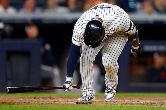 New York Yankees second baseman Gleyber Torres (25) reacts to flying out against the Cleveland Indians during the sixth inning at Yankee Stadium.