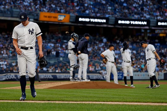 Yankees pitcher Chad Green walks to the dugout after being removed from the game against the Cleveland Indians during the first inning at Yankee Stadium.