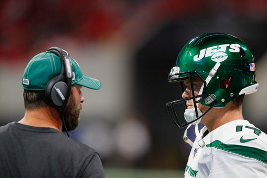 Head coach Adam Gase of the New York Jets converses with Sam Darnold #14 against the Atlanta Falcons during the first half of a preseason game at Mercedes-Benz Stadium on August 15, 2019 in Atlanta, Georgia.
