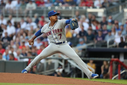 Aug 15, 2019; Atlanta, GA, USA; New York Mets starting pitcher Marcus Stroman (7) delivers a pitch to an Atlanta Braves batter in the first inning at SunTrust Park. Mandatory Credit: Jason Getz-USA TODAY Sports