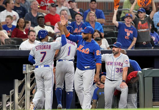 New York Mets Marcus Stroman (7) celebrates with the dugout after scoring against the Atlanta Braves during the fifth inning of a baseball game Thursday, Aug. 15, 2019, in Atlanta. (AP Photo/Tami Chappell)