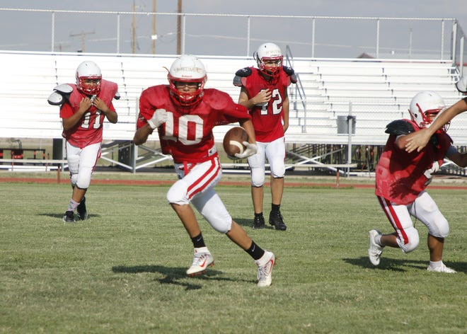 Loving's Gio Martinez returns a punt during the Aug. 14 practice. Loving opens its season Aug. 24 hosting the Carlsbad JV team.