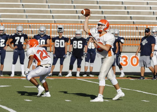 Artesia's Clay Houghtaling throws a pass during a preseason scrimmage against La Cueva. Houghtaling finished the season throwing for 3,536 yards and 46 touchdowns.