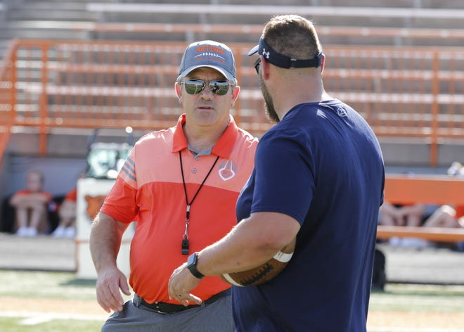 Artesia head coach Rex Henderson talks to a La Cueva coach during a scrimmage in 2019. Henderson resigned from the Artesia football coaching position after spending five seasons with the Bulldogs.