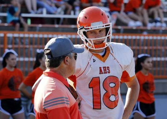 Artesia head coach Rex Henderson talks to quarterback Clay Houghtaling during a scrimmage against La Cueva in August. Houghtaling threw five touchdowns against Hobbs and looks for another big game this Friday at Belen.