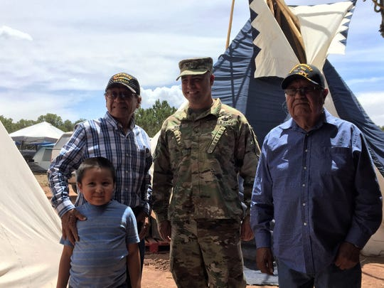 Col. Chris Ward poses with members of the Mescalero Apache Tribe during the Oscura Blessing Ceremony at White Sands Missile Range.