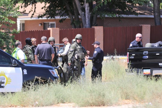 First responders stage at the scene of a barricaded subject along North Tucker Avenue on Aug. 15 in Farmington.