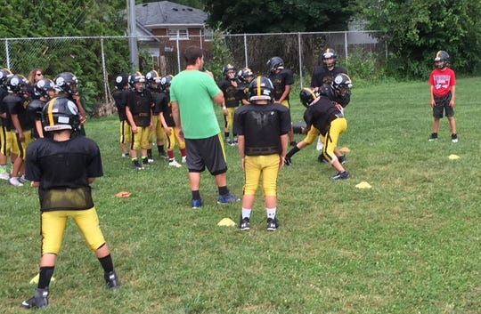 Members of the Plymouth-Canton Steelers freshmen team practice on the field that adjoins the PARC facility.