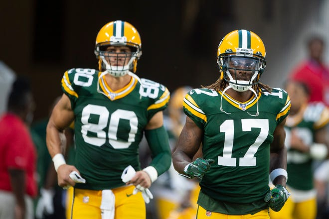 Aug 15, 2019; Baltimore, MD, USA; Green Bay Packers wide receiver Davante Adams (17) and  tight end Jimmy Graham (80) run onto the field before the game against the Baltimore Ravens at M&T Bank Stadium. Mandatory Credit: Tommy Gilligan-USA TODAY Sports
