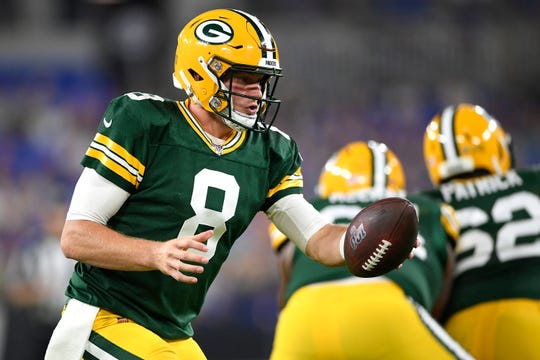Green Bay Packers quarterback Tim Boyle looks to hand off against the Baltimore Ravens during the first half of a NFL football preseason game, Thursday, Aug. 15, 2019, in Baltimore. (AP Photo/Nick Wass)