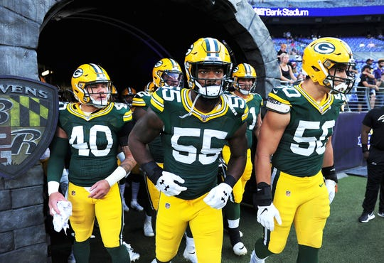 Aug 15, 2019; Baltimore, MD, USA; Green Bay Packers linebacker Za'Darius Smith (55) runs onto the field prior to the game against the Baltimore Ravens at M&T Bank Stadium. Mandatory Credit: Evan Habeeb-USA TODAY Sports
