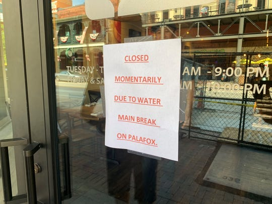 A sign posted on the front door of Urban Swinery warns customers the restaurant is closed Friday afternoon.