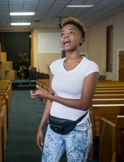 "Keyla Richardson sings at her church on Friday. The Pensacola native was one of four finalists on BET's ""Sunday Best"" singing competition."