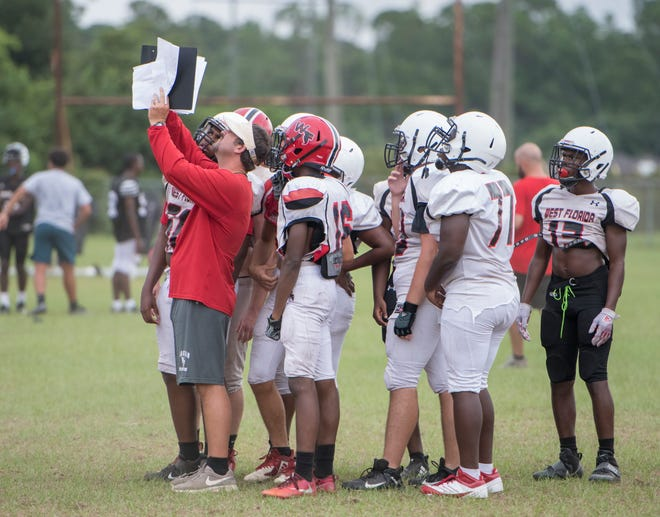 Head coach Rhett Summerford calls a play during football practice at West Florida HIgh School on Wednesday, August 14, 2019.