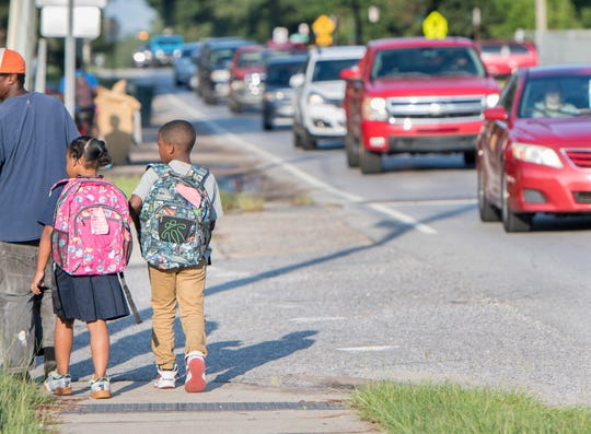 Students makes their way to Montclair Elementary School on Massachusetts Avenue in Pensacola on Aug. 16.