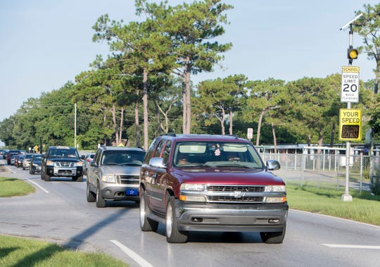 Traffic passes Montclair Elementary School on Massachusetts Avenue in Pensacola on Aug. 16.