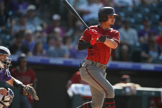 Arizona Diamondbacks third baseman Josh Rojas (9) in the ninth inning of a baseball game Wednesday, Aug. 14, 2019, in Denver. The Rockies won 7-6.