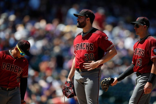 Arizona Diamondbacks starting pitcher Robbie Ray (38) in the second inning of a baseball game Wednesday, Aug. 14, 2019, in Denver.