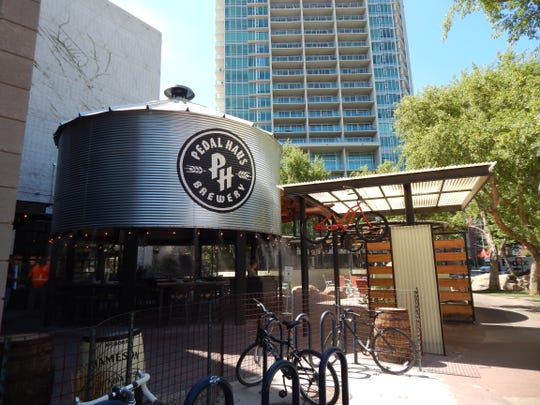 Sit outside on the patio at Pedal Haus Brewery on Mill Avenue in Tempe.