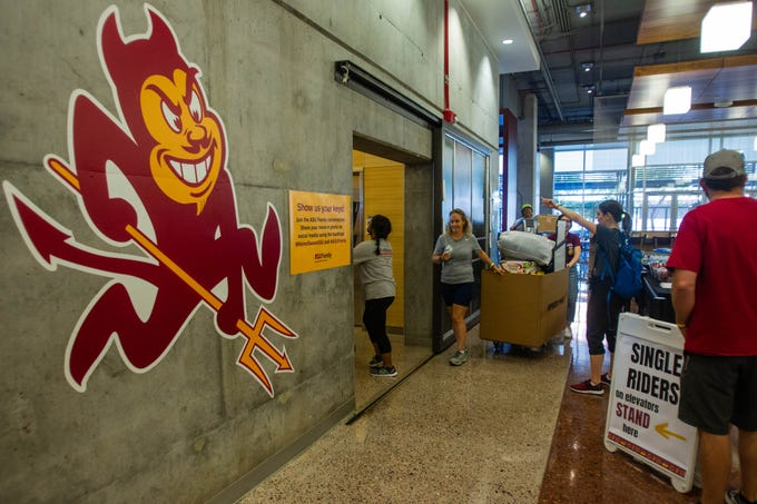 Incoming freshmen are moved into the Downtown Arizona State University campus dorms by Sparky's Welcome Team on Aug. 16, 2019.
