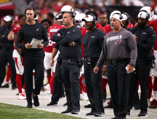 Cardinals head coach Kliff Kingsbury, assistant head coach Jeff Rodgers and defensive coordinator Vance Joseph look on from the sideline during the first half of a preseason game Aug. 15 at State Farm Stadium.