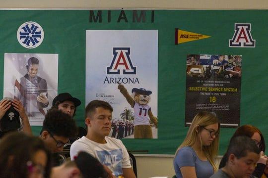 In response to low college attendance rates, college advertisements fill Miami Junior-Senior High School in Miami, Ariz., on Aug. 12, 2019.