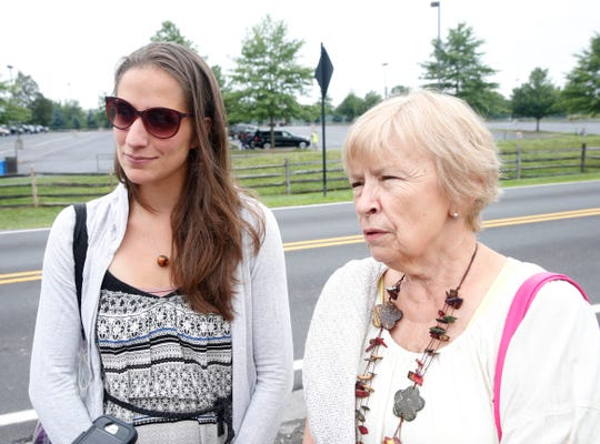 From left, Sarah Punturiero and Anne Roseberry of Buffalo, New York arrive  at Bethel Woods Center for the Arts to celebrate the 50th anniversary of Woodstock on August 16, 2019. Despite being a generation apart, the two have found friendship and a kindred admiration for Woodstock.