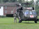 A flight crew member exits a helicopter near the Fort Hunter Boat Launch during 'Operation Hurricane', a full-scale emergency simulation demonstration on the Susquehanna River on August 15, 2019.