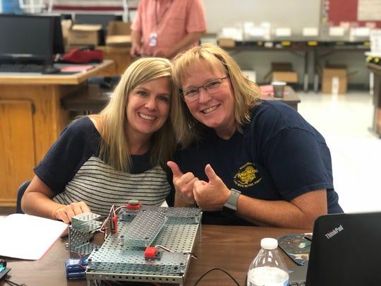 Lyon County School District teachers  (left) and Dusti Houk during robotics training.