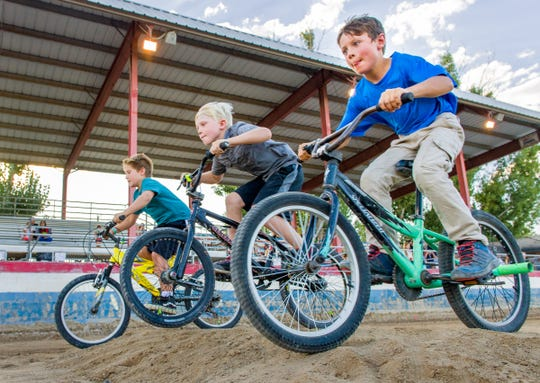 Kids compete in the BMX bike races.