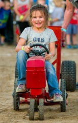 Bailey Loveday, 6, has fun participating in the kids' tractor pull.