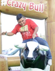 Margarito Nieves, 10, of Yerington, rides a mechanical bull.
