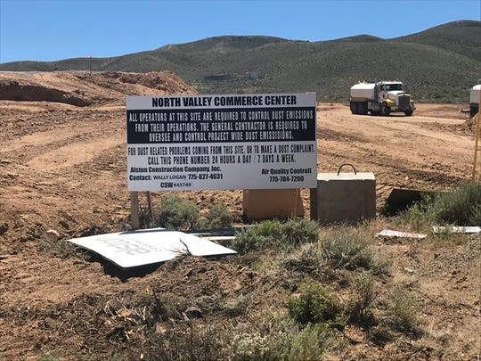 Crews work to mass-grade the site of the North Valleys Commerce Center in early July 2019.