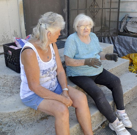 Troyann Cada (left) talks with Nancy Fogg during a delivery.