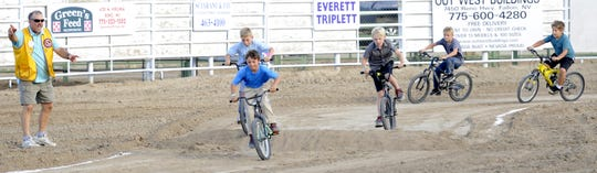 Eight and nine-year-old boys ride in the Lion's Club BMX bike race.