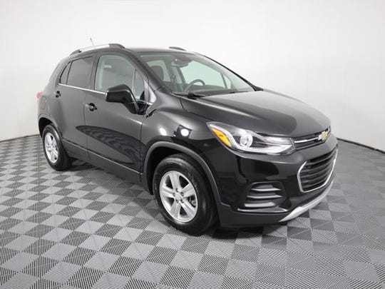 Police are searching for a dark or black Chevrolet Trax similar to the photo provided.