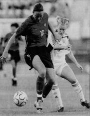 Aug. 12, 2004: Abby Wambach, left, plays during an Olympic soccer match. The U.S. won 3-0.