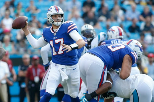 Buffalo Bills quarterback Josh Allen (17) works against the Carolina Panthers during the first half an NFL preseason football game, Friday, Aug. 16, 2019, in Charlotte, N.C.