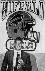 August 1986: Jim Kelly smiles at a Buffalo news conference after signing with the Bills.
