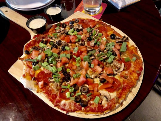 The popular Downtown combo pizza at the Downtown Bar & Grill across from the Cascade Theatre.