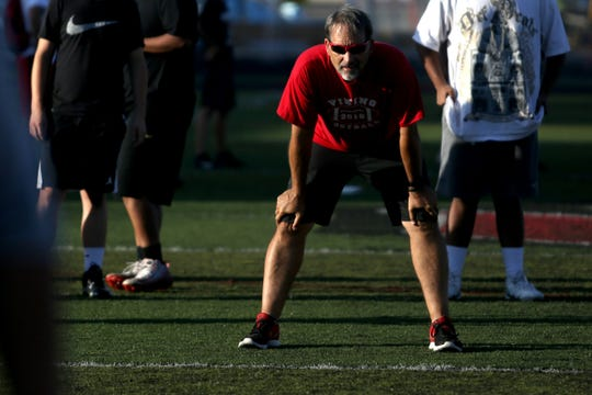 Head coach Jeff Flood leads a practice before the football season starts at North Salem High School on Aug. 15, 2019.