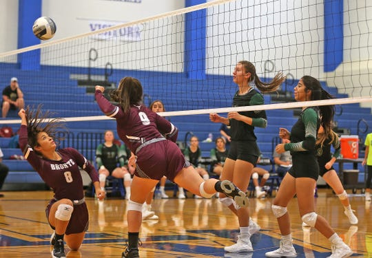 Bronte High School's Karissa Cervenka (8) digs a ball as Dree Davis (9) reacts in a match against Grape Creek compete in the 2019 Nita Vannoy Memorial Volleyball Tournament in San Angelo on Friday, Aug. 16, 2019.
