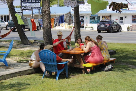 A group of customers dines at Woody's Beach BBQ on Wednesday, Aug. 7.
